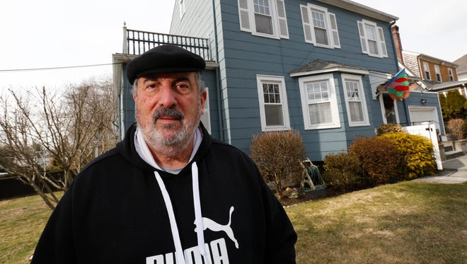 Leonard Verrastro, 67, in front of his home in Larchmont. He is fighting his Larchmont village assessment.