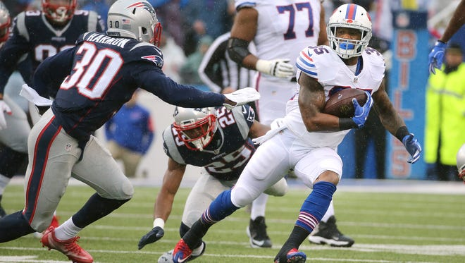 Bills running back Mike Gillislee finds running room against Patriots Duron Harmon.