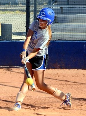 Carlsbad's Gabby Aragon makes contact hitting the ball as the team simulates facing faster pitching during Wednesday's practice. The Cavegirls will host Hobbs in a Friday doubleheader.