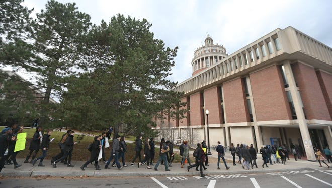 Student protesters march across campus and to Rush Rhees Library at University of Rochester.