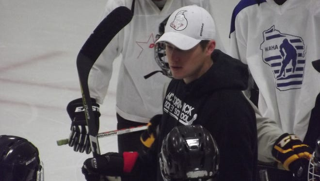 Max McCormick goes over a drill with U15 players at his hockey camp on Friday at the Cornerstone Community Center. The 2010 Green Bay Notre Dame alum is hoping to make the full-time roster of the Ottawa Senators after appearing in 20 games with the NHL franchise last season.