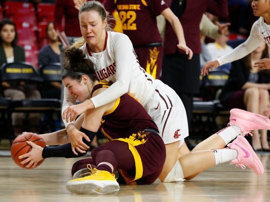 Washington State's Louise Brown (4) tackles ASU's Robbi Ryan (11) going for a loose ball during the second half at Wells Fargo Arena on February 4, 2018 in Tempe, Ariz. Both players were called for technicals after Ryan retaliated.