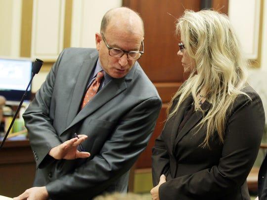 Defense attorney Mike Allen cautions Lisa Hamm not