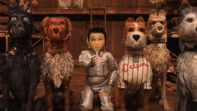 """Chief, voiced by Bryan Cranston, (from left) King, voiced by Bob Balaban, Atari Kobayashi, voiced Koyu Rankin, Boss, voiced by Bill Murray, Rex, voiced by Edward Norton, And Duke, voiced by Jeff Goldblum, appear in a scene from """"Isle of Dogs."""""""