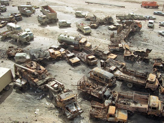 A devastated convoy of vehicles on a highway north