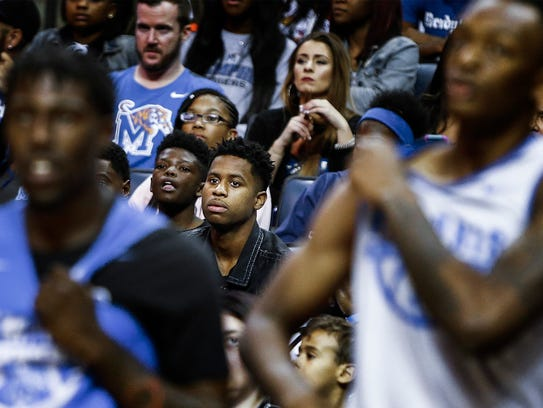 Tigers recruit Tyler Harris (middle) watches the action during Memphis Madness at the FedExForum Wednesday, Oct. 12, 2017.
