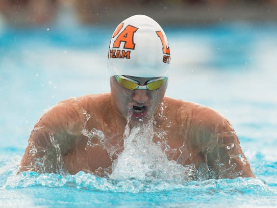 Lincoln Park Academy's Terry Gardner swims the breaststroke