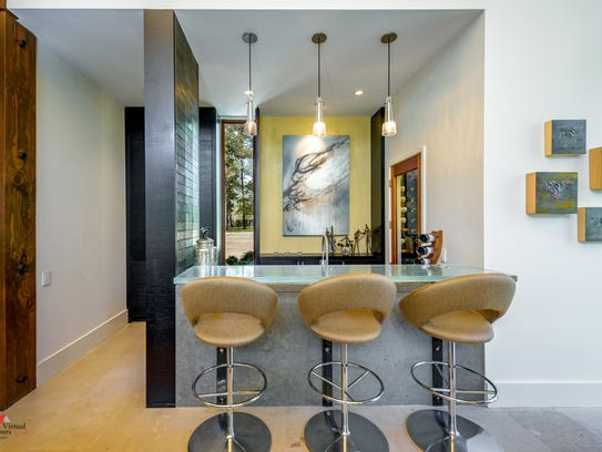 The wet bar features a custom glass bar made in Canada.