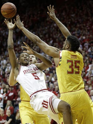 Maryland forward Damonte Dodd gets a hand on a shot from Indiana's Troy Williams. B1G men's basketball game Sunday, Mar 6, 2016, afternoon at Assembly Hall in Bloomington.