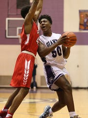 Ben Davis Giant Aaron Henry (50) is Boys Basketball athlete of the week.