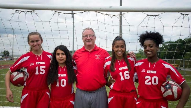 Erwin is coming off its best season in girls soccer in quite some time. From left to right, Mackenzie Hoerchel, Pamela Cazares, coach Dan Heath, Desira Lee and Amber Redmon.
