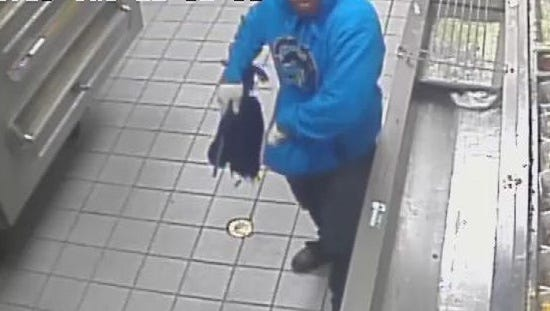Security camera footage provided by Domino's shows the suspect yelling at an employee.