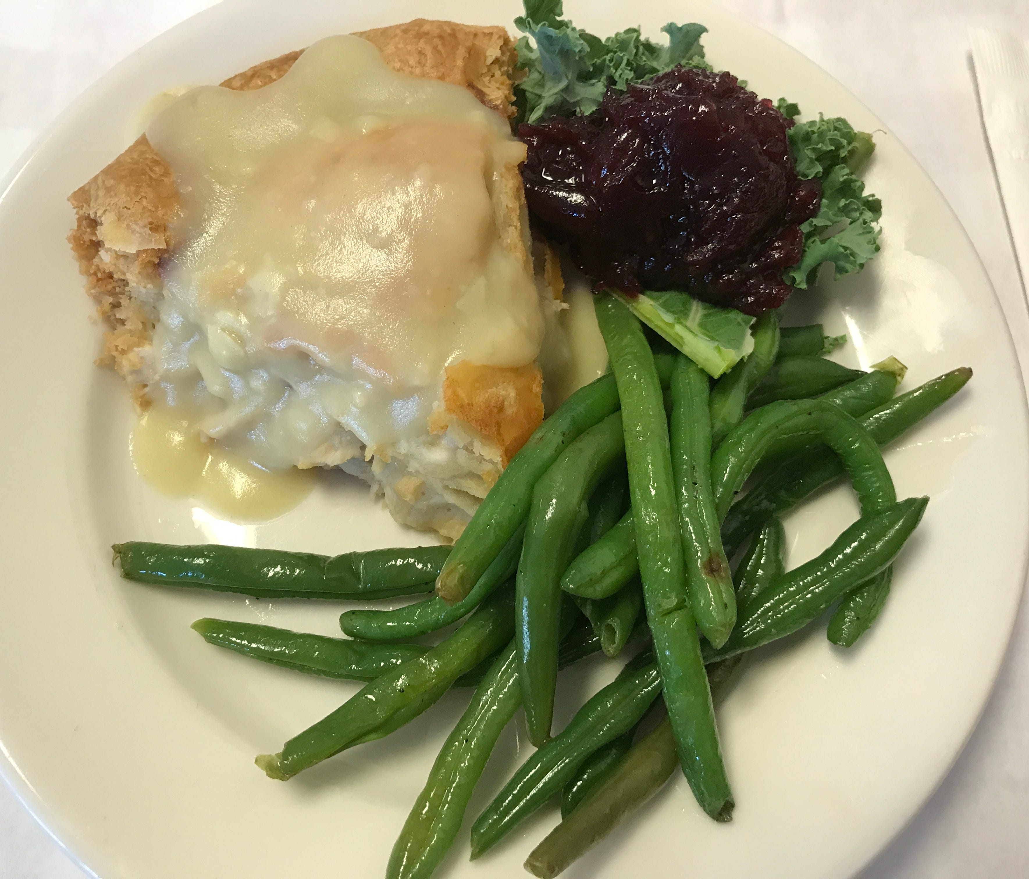 The main event at Centerville Pie Company and the dish that made Oprah's Favorite Things list is the Signature Chicken Pie, with nothing but lots of meaty chicken and gravy. It is on the menu every day and served with a veggie side and cranberry sauc