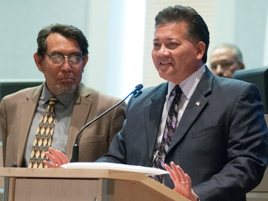 Las Cruces Mayor Ken Miyagishima, right, speaks Monday about Miguel Silva's service to the city during Silva's last day as a city councilor. Silva has been the councilor for District 1 since 2007. He challenged Miyagishima for the mayor's seat this year.