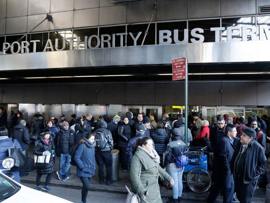 Pedestrians jam the back of the Port Authority Bus Terminal following an explosion inside an underground tunnel in the building in New York City on Dec. 11, 2017.