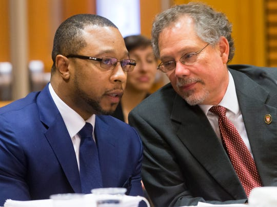 Attorney Jarrett Adams (left) talks with Keith Findley on Feb. 14 in Dane County Court in Madison. Adams was wrongfully convicted at age 19 of rape and now works for the Wisconsin Innocence Project. He is part of a defense team representing Richard Beranek working for post-conviction relief from a sexual assault conviction after new DNA testing proves hair found at the scene of the crime did not belong to Beranek. Findley is co-director of the Wisconsin Innocence Project.
