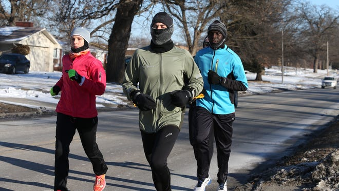 Members of the Capital Striders running group hit the road early Feb. 28 in Des Moines.