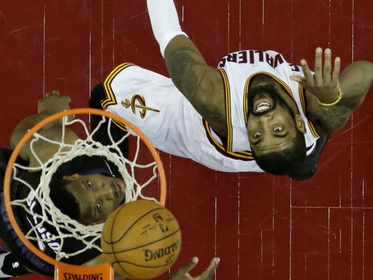 Cleveland Cavaliers' Kyrie Irving, right, and Phoenix