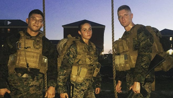 After a 5-mile endurance course practice run with a full load of gear, 2nd Lt. Piele, left, 2nd Lt. Gomez and Lt. Kult pose for a photo.
