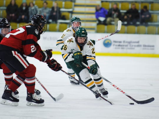 Catamount forward Eve-Audrey Picard (26) skates with the puck during the women's hockey game between the Northeastern Huskies and the Vermont Catamounts at Gutterson Fieldhouse on Friday night January 26, 2018 in Burlington.