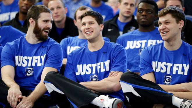 Creighton players, in the front row from left, Ethan Wragge, Doug McDermott and Grant Gibbs talk during a live broadcast of the Selection Sunday show in Omaha, Neb., Sunday, March 16, 2014.