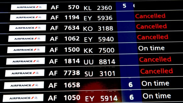 A departure board showing cancelled flights is pictured