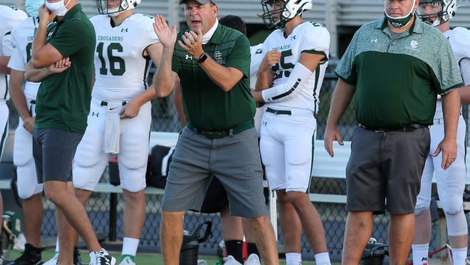 Central Catholic coach Jeff Lindesmith shouts encouragement to his players during their Week 2 loss at Perry on Friday, Sept. 4, 2020.