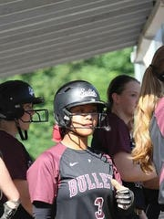 Anna Aguon, center, was named the Greater St. Helen's League Co-Player of the Year for softball as a junior at Union High School in Vancouver, Washington. She also plays for the Bullets Northwest, a traveling softball team.