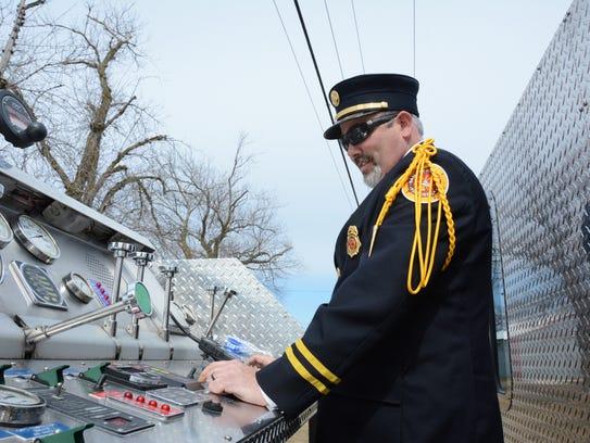 Door County firefighters left the funeral of former