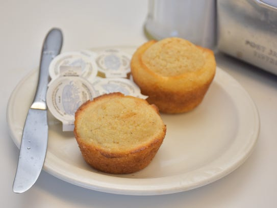 Cornbread muffins complement a bowl of warm soup.