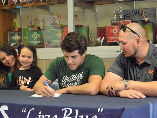 Piedra Vista's Nick Rino signs his letter of intent on Nov. 14 to continue his wrestling career at NCAA Division I Utah Valley University.