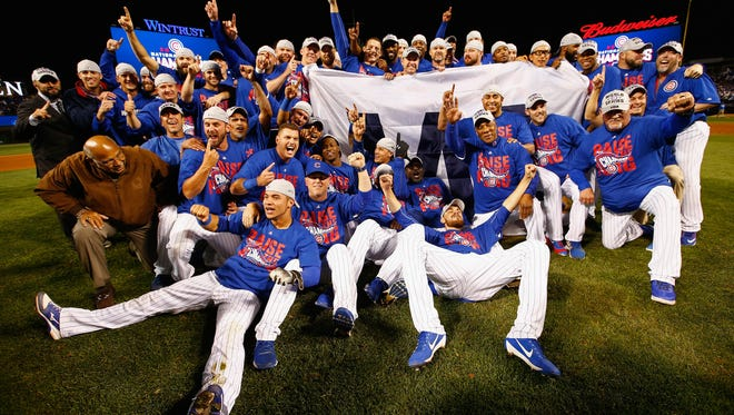 617306812.jpg CHICAGO, IL - OCTOBER 22:  The Chicago Cubs pose after defeating the Los Angeles Dodgers 5-0 in game six of the National League Championship Series to advance to the World Series against the Cleveland Indians at Wrigley Field on October 22, 2016 in Chicago, Illinois.  (Photo by Jamie Squire/Getty Images)