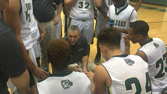 Berea coach Jeff Maness talks to his team during a timeout late in the Bulldogs' 83-66 win over Travelers Rest in the Greenville County Tip-Off Tournament Tuesday night.