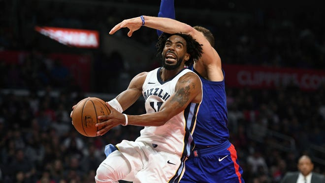 Grizzlies guard Mike Conley, left, is fouled by Clippers forward Blake Griffin while driving to the basket during the second half Saturday.