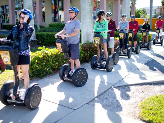 A group on people enjoy a tour from Segway of Naples