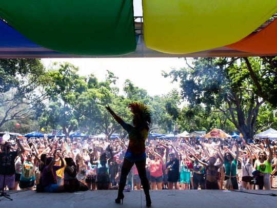Drag queen Tp Lords pumps up the crowd during her performance