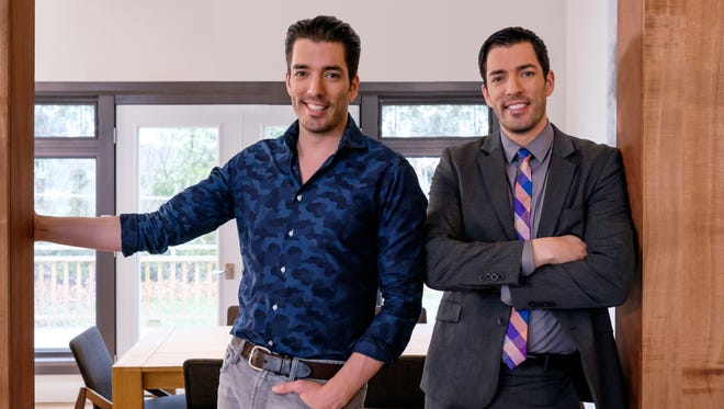 """Property Brothers"" hosts Jonathan, left, and Drew Scott pose in the dining room of a recently renovated home in Toronto. They are filming in the Lower Hudson Valley for seven months."