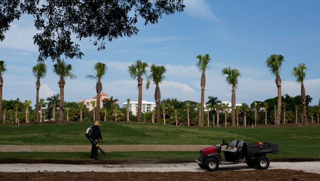 A worker stands out at Naples Beach Club golf course on July 22, 2016. The course is currently undergoing renovation.
