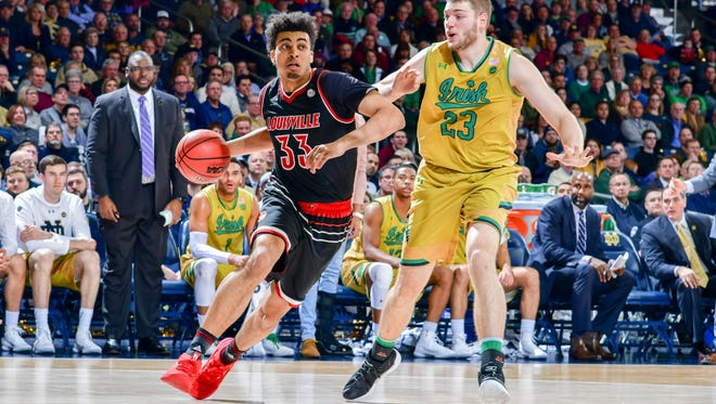 Louisville Cardinals forward Jordan Nwora (33) dribbles as Notre Dame Fighting Irish forward Martinas Geben (23) defends in the first half at the Purcell Pavilion.