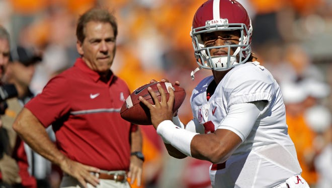Alabama quarterback Jalen Hurts (2) warms up before an NCAA college football game against Tennessee as Alabama head coach Nick Saban watches Saturday, Oct. 15, 2016, in Knoxville, Tenn.