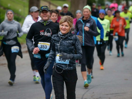 Runners make their way along the route during the 2017 Drake Road Races half marathon and 5K on Saturday, April 29, in Des Moines.