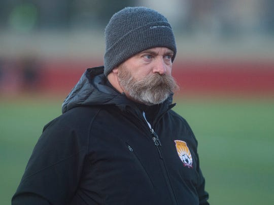 Rocky Mountain High School soccer coach Ron Clark watches the Lobos take on Fossil Ridge on Thursday, March 29, 2018.