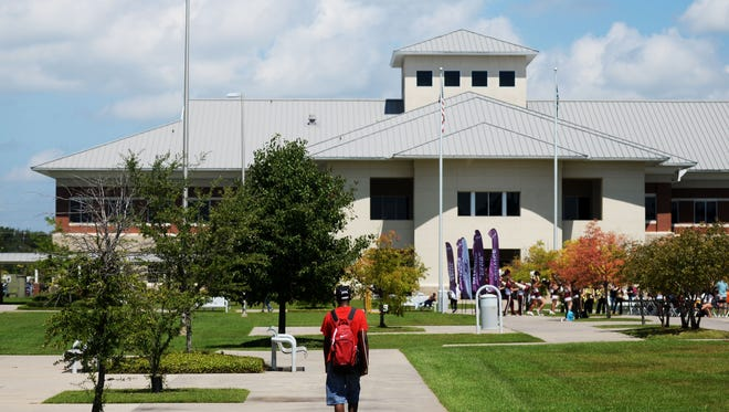 A student walks on the Bossier Parish Community College's campus.