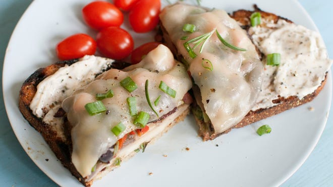 Open-faced stuffed portobello sandwich is made in the style of a Philly cheesesteak.