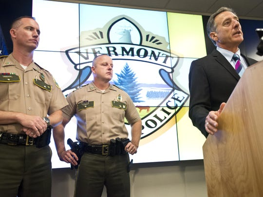 From left, Vermont State Police Lt. Col. Matt Birmingham and Col. Tom L'Esperance listen as Gov. Peter Shumlin talks about Vermont's efforts in helping with search for two escaped New York inmates during a news conference Thursday morning in Waterbury.