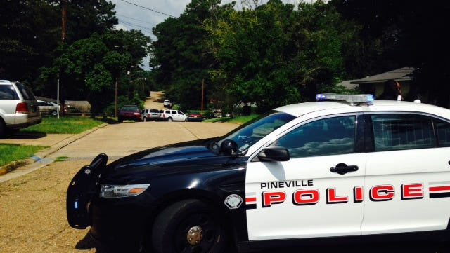 A Pineville Police officer shot a suspect Monday morning on Cummins Street after a disturbance call, according to a city spokesman.