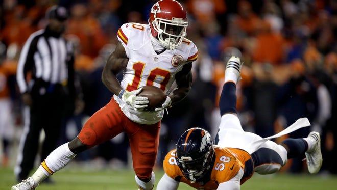 Kansas City Chiefs receiver Tyreek Hill escapes the reach of Denver Broncos linebacker Von Miller for a touchdown during the second half Nov. 27, 2016, in Denver.
