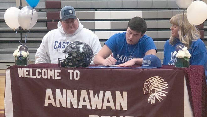 Drake Van Hyfte signs his national letter of intent for Eastern Illinois University during a a ceremony Wednesday at Annawan High School that was attended by his parents, Ted and Valerie Van Hyfte.