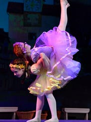 """Addison Meuth lifts Madison Riley up during the village scene in """"Hansel and Gretel"""" Friday by Dance, Ltd.-School of Dance."""