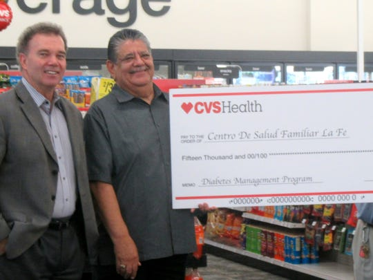 State Rep. Joe Pickett, far left, of El Paso, took part in a CVS Pharmacy check presentation to Robert Gonzales, chief operations officer at La Fe Clinc, from Ernest Reyes, and Daniel Urenda of CVS during the Aug. 19 grand opening of the new CVS drugstore at 1780 N. Lee Trevino in East El Paso. CVS donated $15,000 to La Fe.